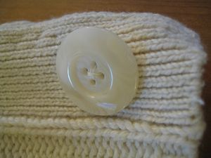 Sweater hat button